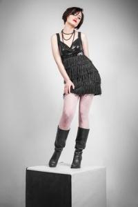 young beautiful woman in black mini dress